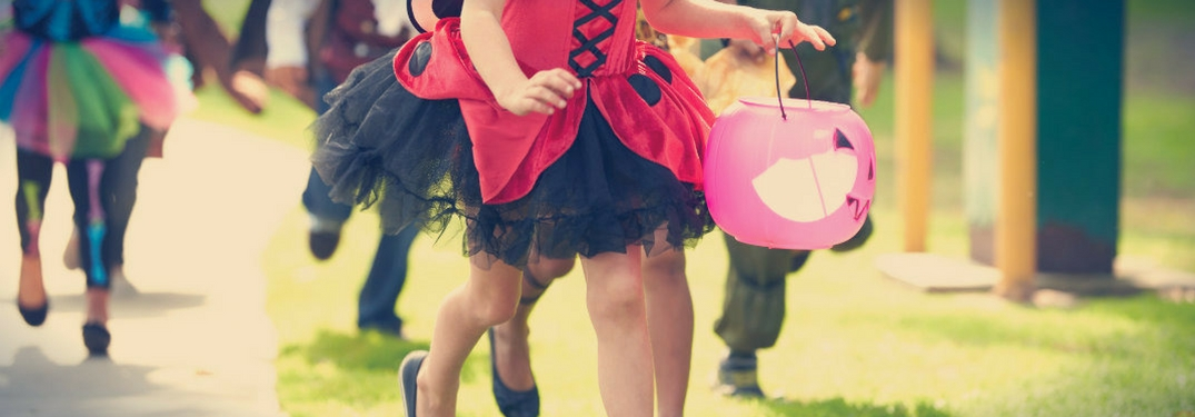 children trick or treating, only legs visible