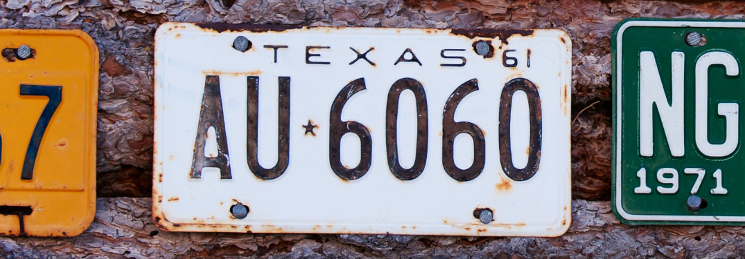 old Texas license plate on a wall