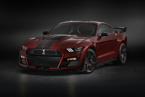 A red 2020 Ford Mustang Shelby GT500 front-angled exterior view with a black background.