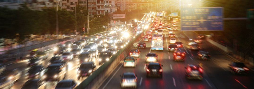 "Many cars drive along a highway at night through a city. One can't help but wonder: ""How many of those drivers own more than one car?"""