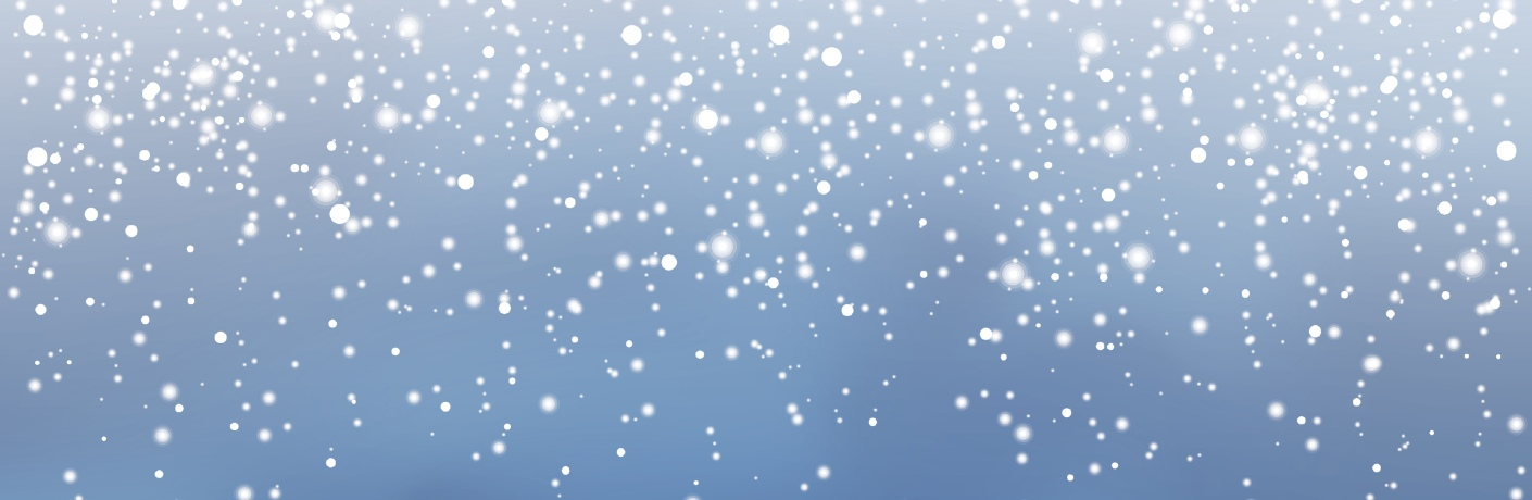 Falling snow against a blue sky.