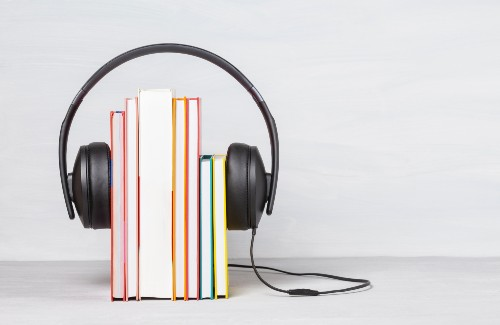headphones over a group of upright books