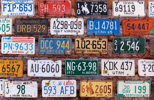 wall of old license plates from different states