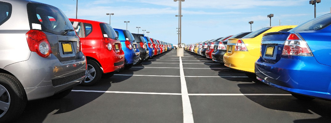 A stock photo of a vehicles lined up at a dealership.