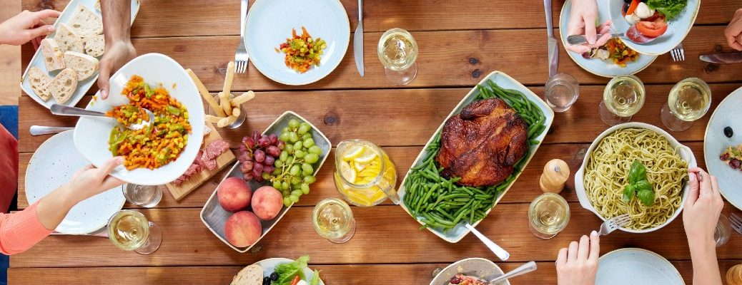 A stock photo of a table set of Thanksgiving dinner.
