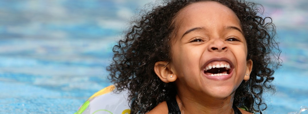 A stock photo of a child swimming.