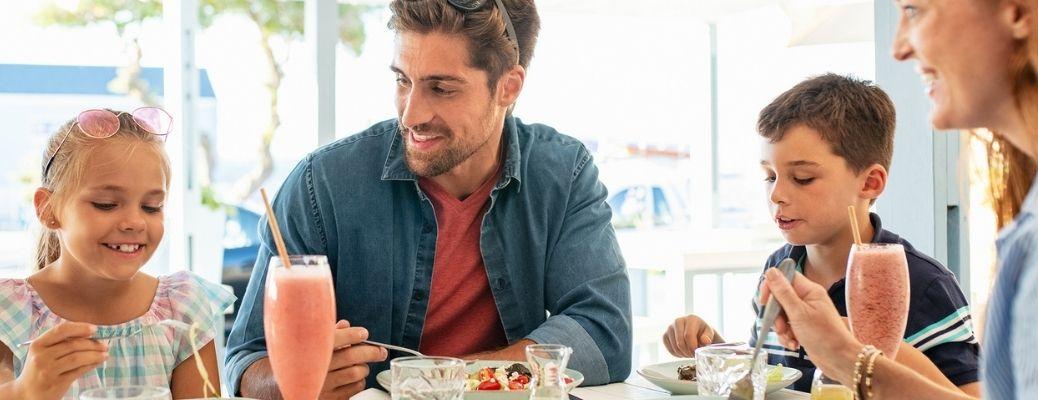 A family eating at a vegan restaurant