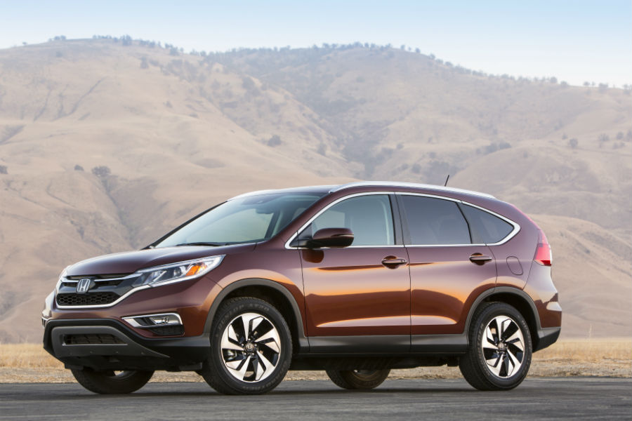 2015 honda cr v crossover in desert profile view with wheels and fenders_o