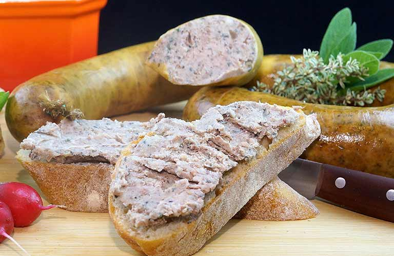 Image of German-style sausages and bread on a cutting board