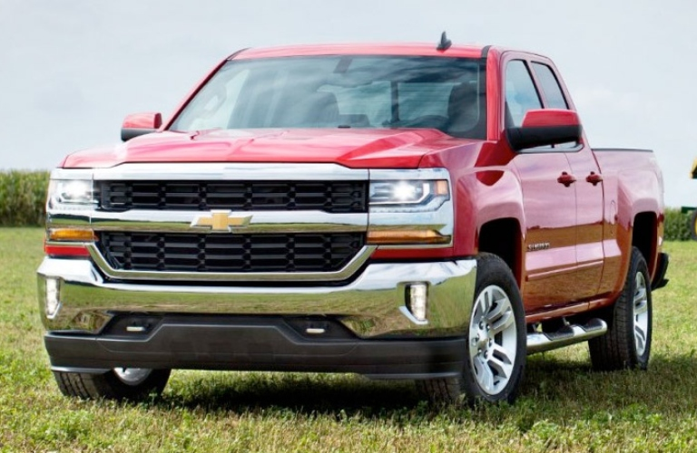 Exterior view of a red 2017 Chevrolet Silverado 1500 parked in an empty farm field