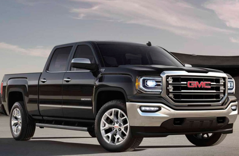 Exterior view of a black 2017 GMC Sierra 1500 parked in a parking lot