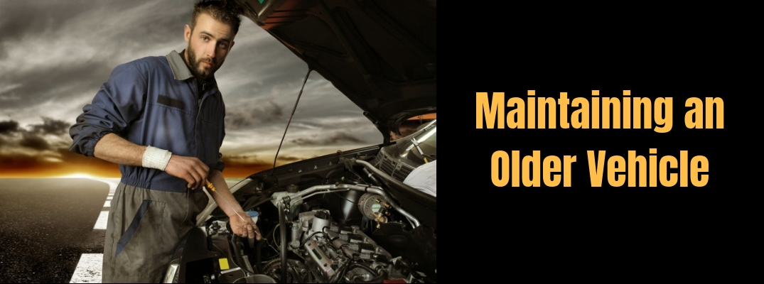 "Image of a auto mechanic checking out a vehicles engine with ""Maintaining an Older Vehicle"" in orange font against a black background"