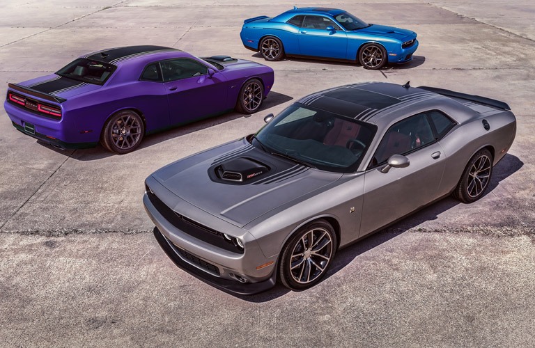 Exterior view of three 2016 Dodge Challenger models