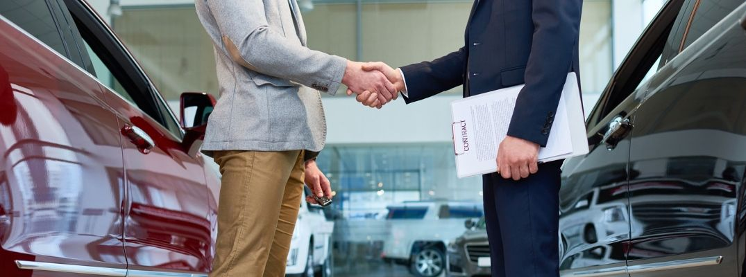 Image of two people shaking hands after completing a vehicle trade agreement