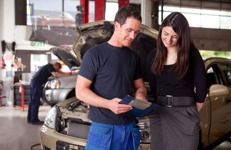 Image of a service technician going over the service report with a female customer