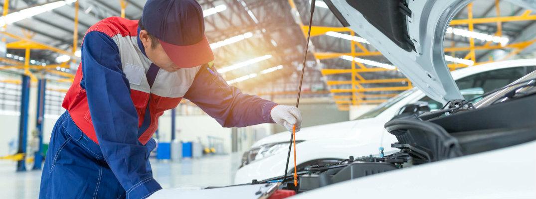 Car mechanic inspecting an engine