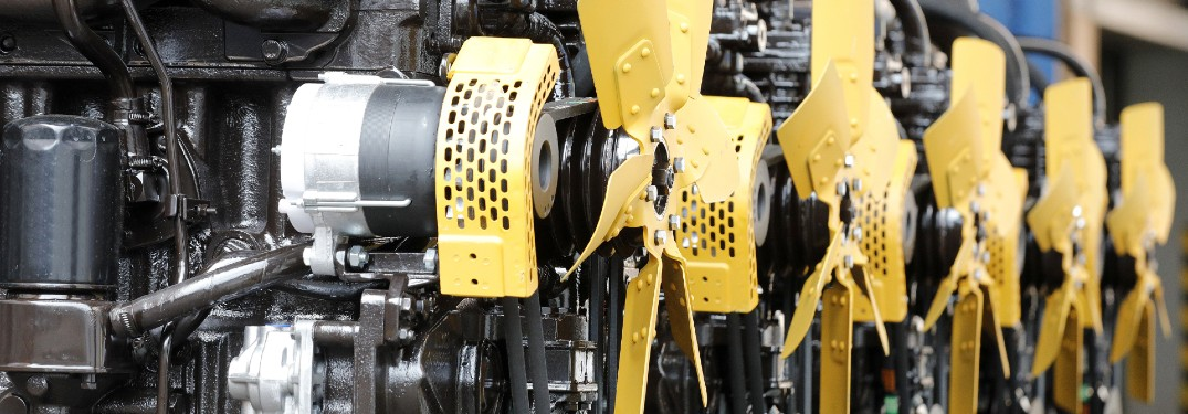 row of five engines with yellow fans