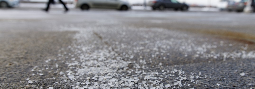 road salt on ground in parking lot