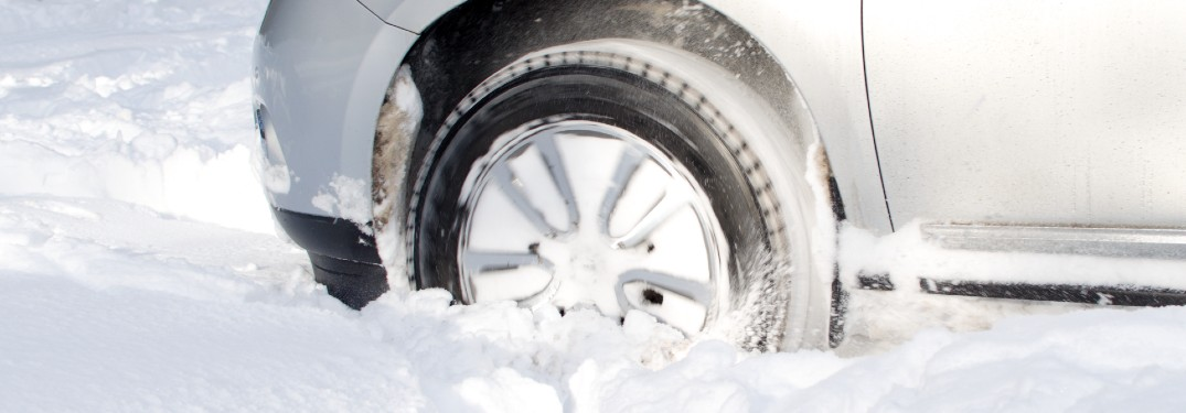 close up of car driving through thick snow