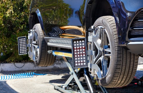 car with equipment for aligning wheels