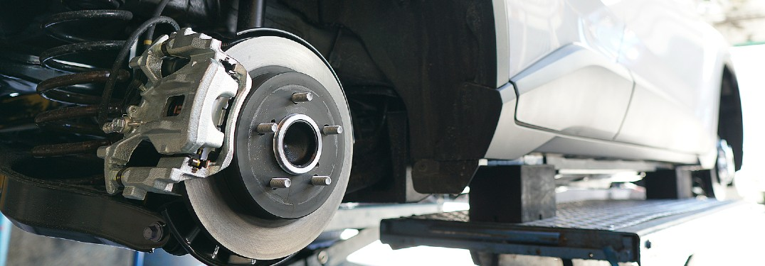 car in shop with brake disc exposed