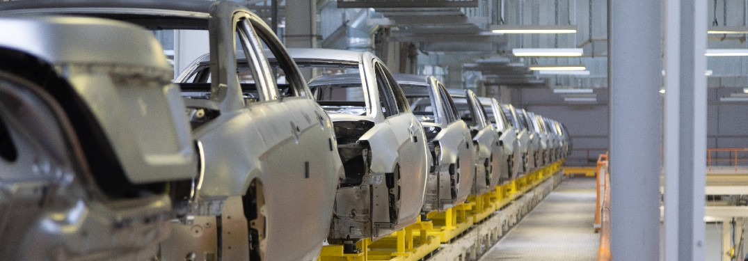 frames of cars in automotive production factory