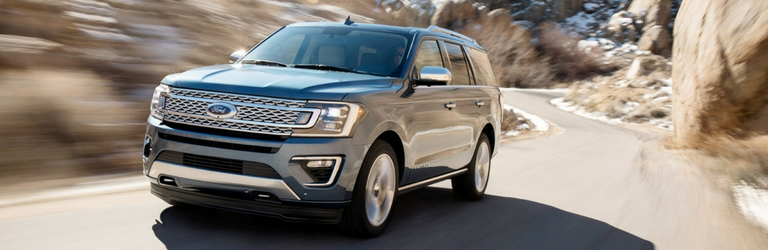 2018 Ford Expedition driving down a road.