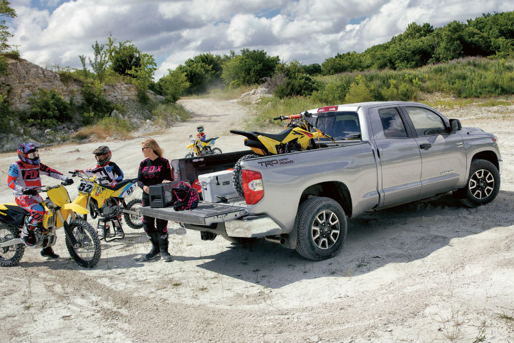 family loading dirt bikes into the bed of the 2018 Toyota Tundra