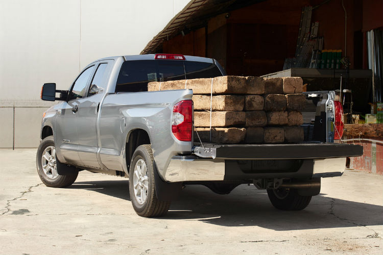 2018 Toyota Tundra with lumber in its bed