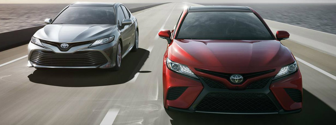 Two 2018 Toyota Camry models driving down a highway
