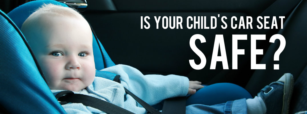 "Baby in a car seat with the words ""Is your child's car seat safe?"""