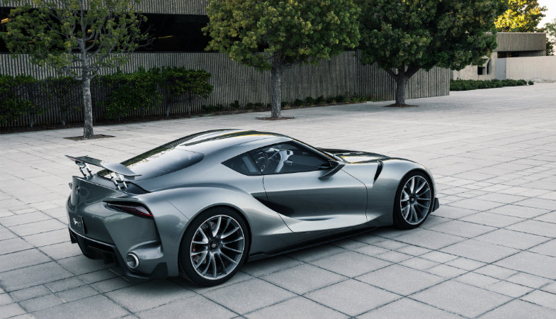 Toyota FT-1 Concept parked by a modern building