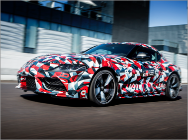 2019 Toyota Supra parked in front of a building