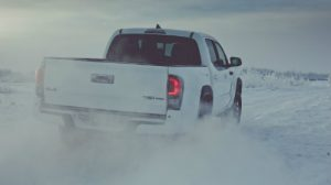 2019 Toyota Tacoma TRD Pro driving on a snowy day