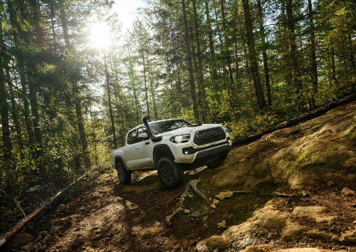 2020 Toyota Tacoma TRD Pro driving through the woods