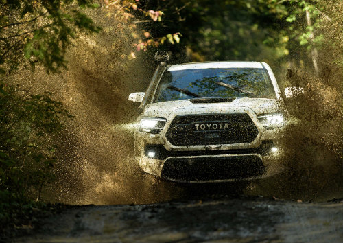 2020 Toyota Tacoma driving through the dirt
