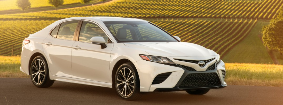 2018 Toyota Camry in front of a field