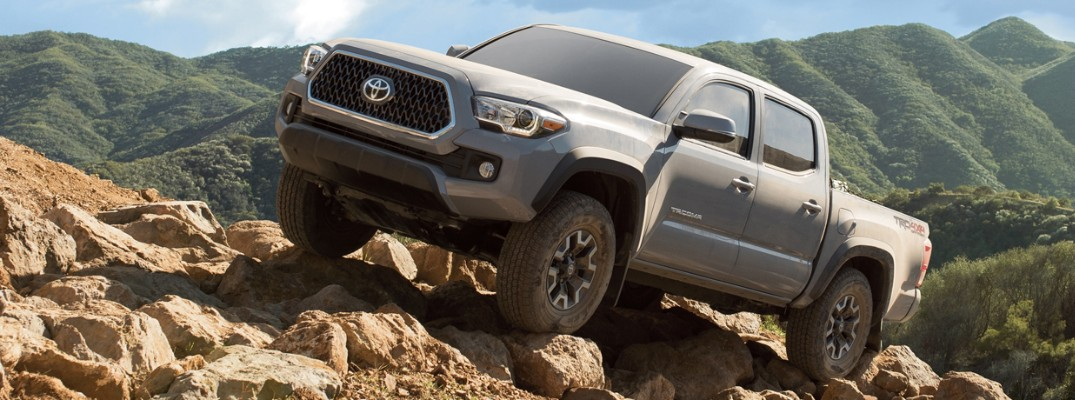 2019 Toyota Tacoma driving up a hill