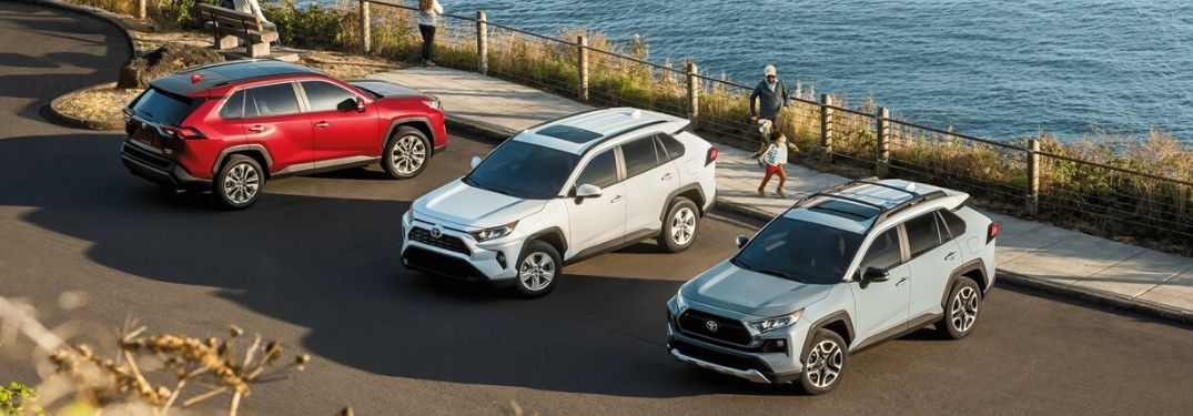 three 2020 Toyota RAV4 models parked by water's edge