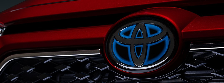 Close-up of Toyota logo on RAV4 Prime Plug-In Hybrid