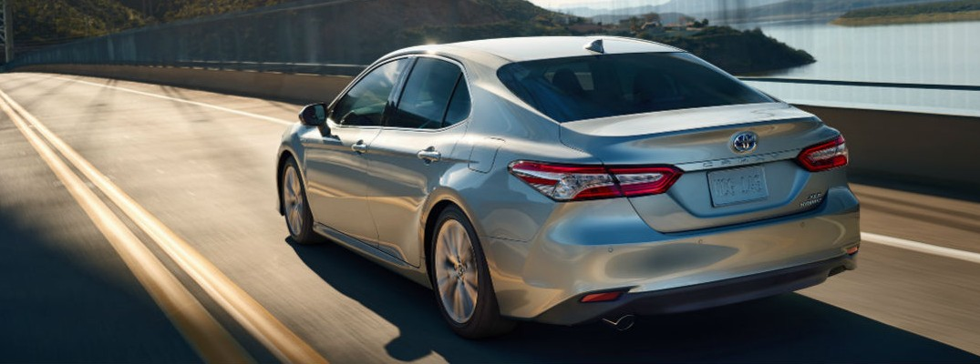 2020 Toyota Camry driving over a bridge