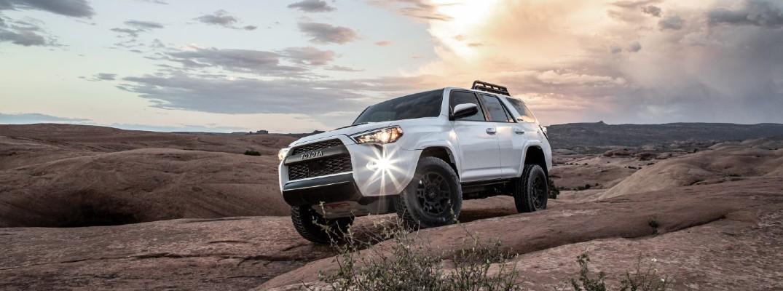 2020 Toyota 4Runner TRD Pro driving through the desert at sunset