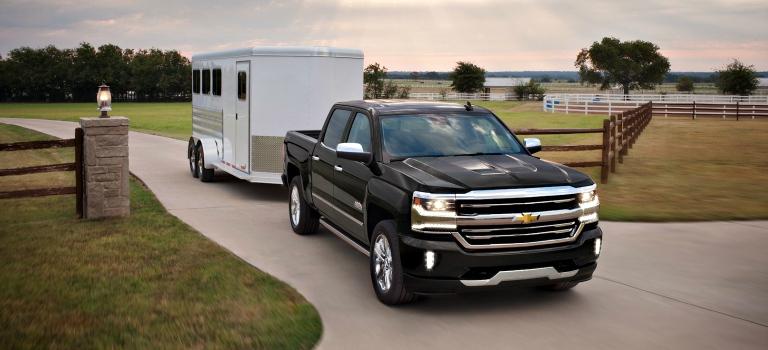 2018 Silverado 1500 black front view towing a white trailer