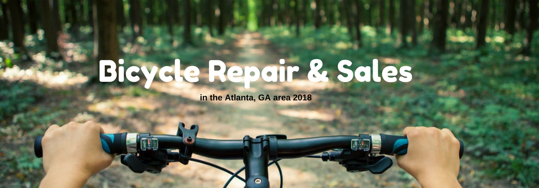 Bicycle Repair & Sales in the Atlanta, GA area, text on an image from behind the handle bars of a bike going down a dirt trail