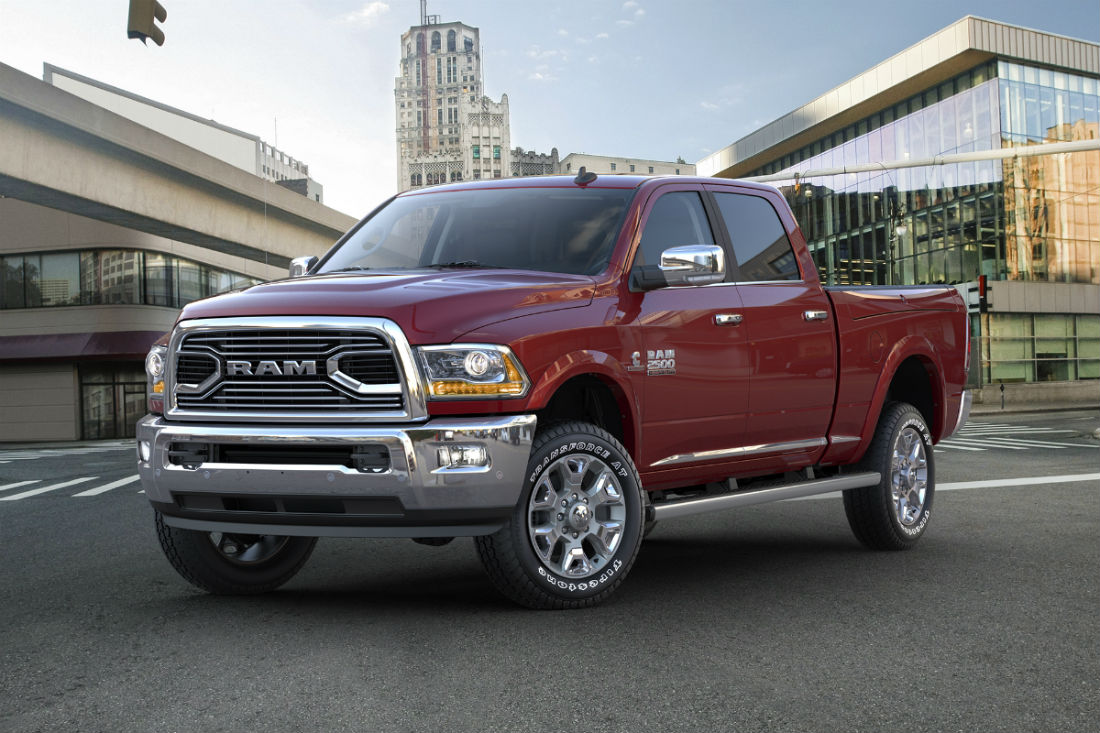 Front driver side exterior view of a red 2017 Ram 2500