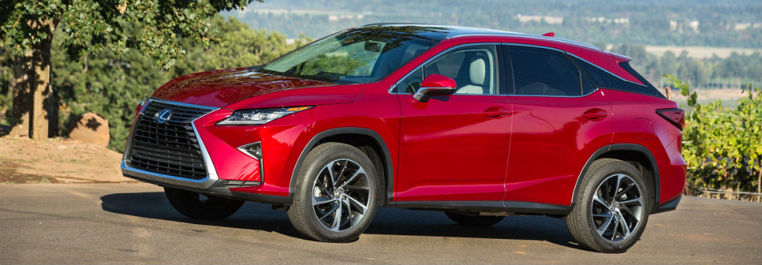 Driver side exterior view of a red 2016 Lexus RX 350