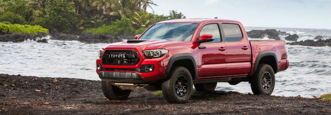 Driver side exterior view of a red 2017 Toyota Tacoma