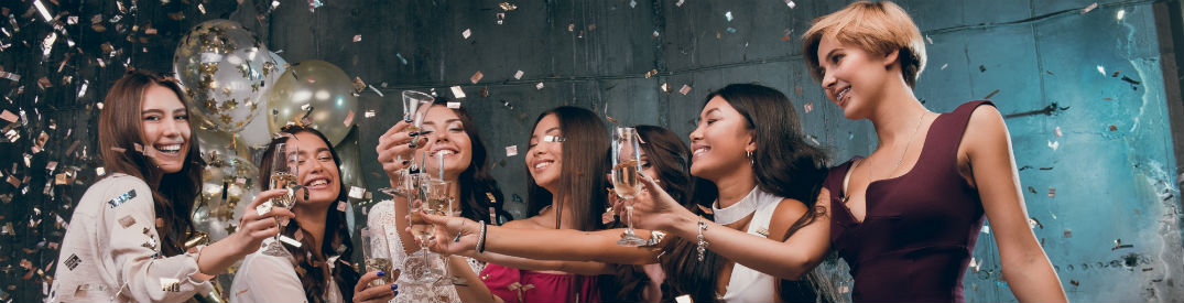 Attractive women posing with champagne glasses