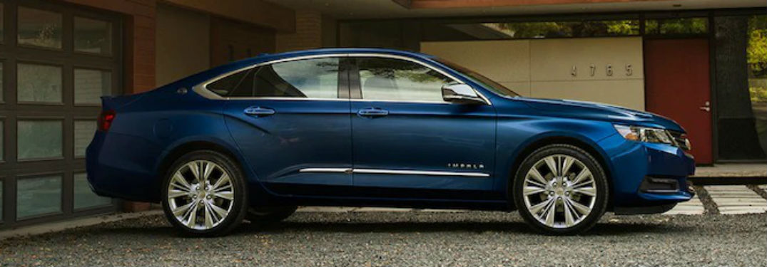 Passenger side exterior view of a blue 2018 Chevy Impala