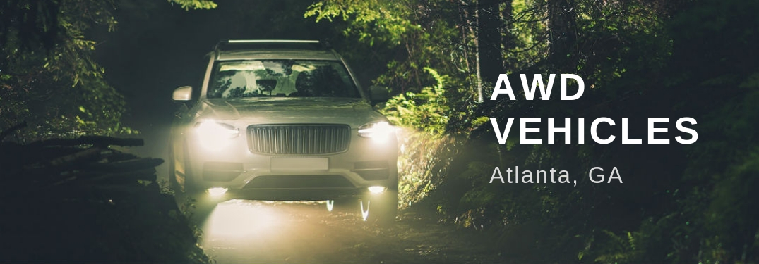 AWD Vehicles Atlanta, GA, text on an image of an SUV driving on a secluded trail in the dark